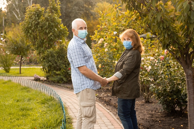 Elderly seniors couple wearing medical mask