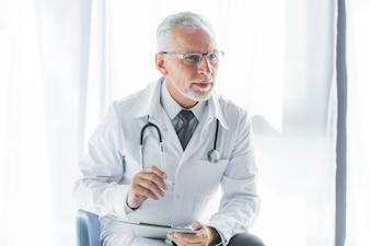 Elderly therapist listening to patient