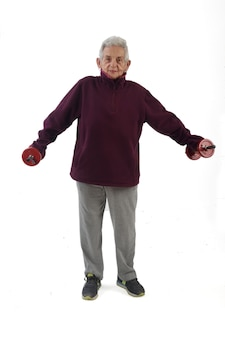 An elderly woman doing dumbbells on white background