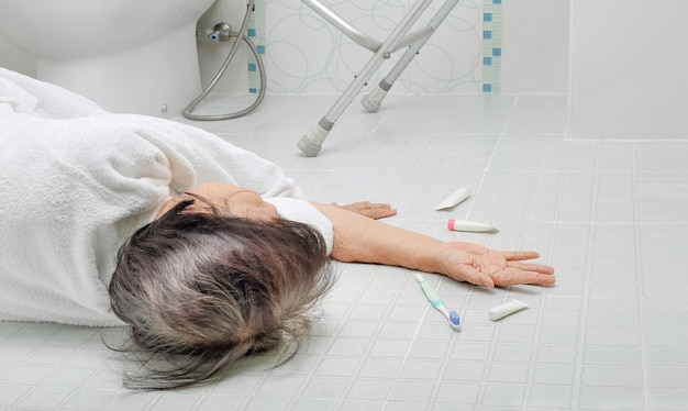 Elderly woman falling in bathroom because of the slippery surfaces