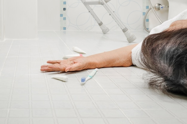 Elderly woman falling in bathroom because slippery surfaces