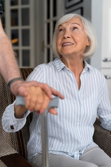 Elderly woman looking at her caregiver