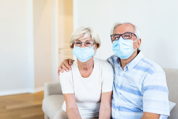 Elderly woman and man with facial masks