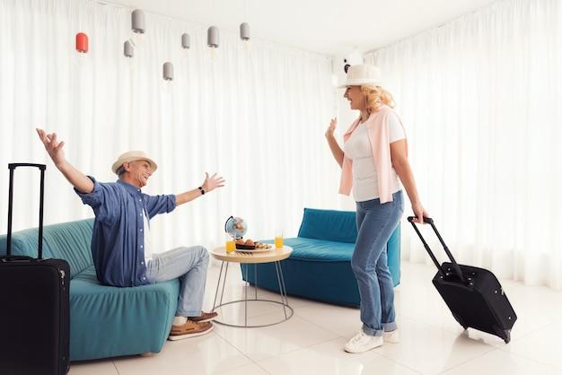 An elderly woman met an elderly man at the airport
