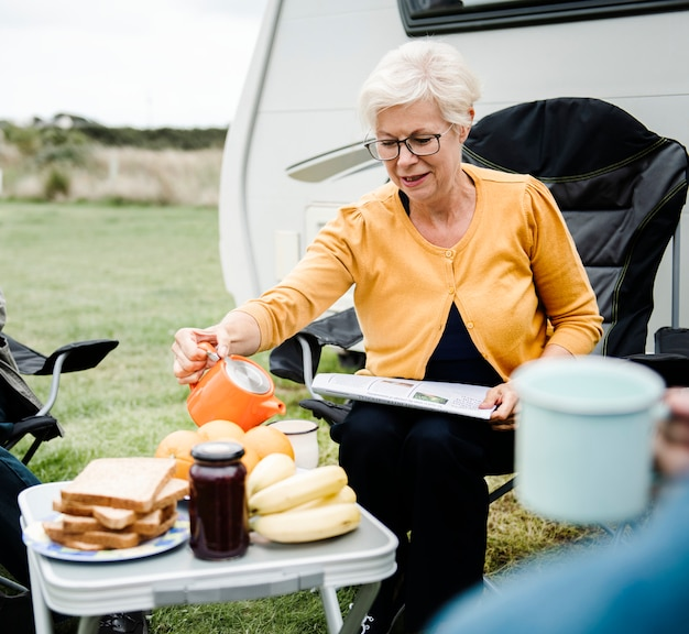 Elderly woman pouring a cup of coffee