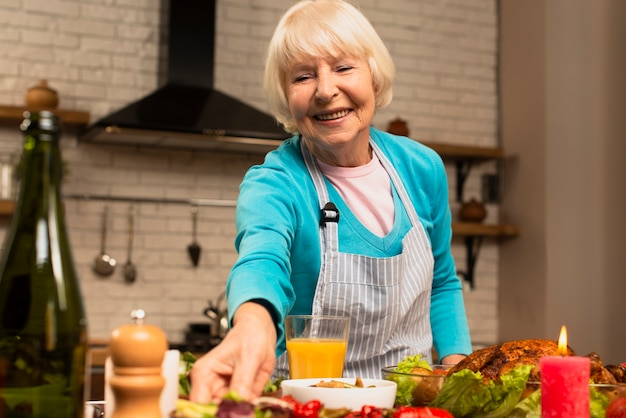 Elderly woman preparing the thanksgiving meal front view