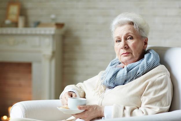Elderly woman in striped scarf