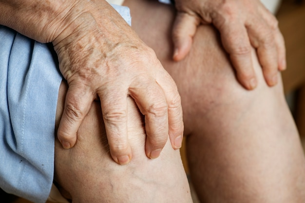 Elderly woman suffering knee pain