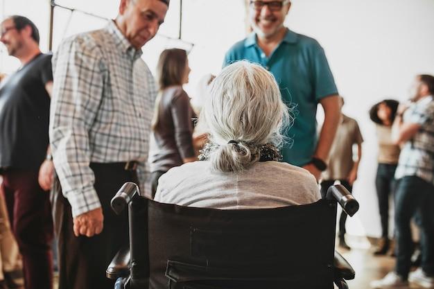 Elderly woman talking with friends