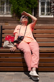 Elderly woman traveling alone in the summer