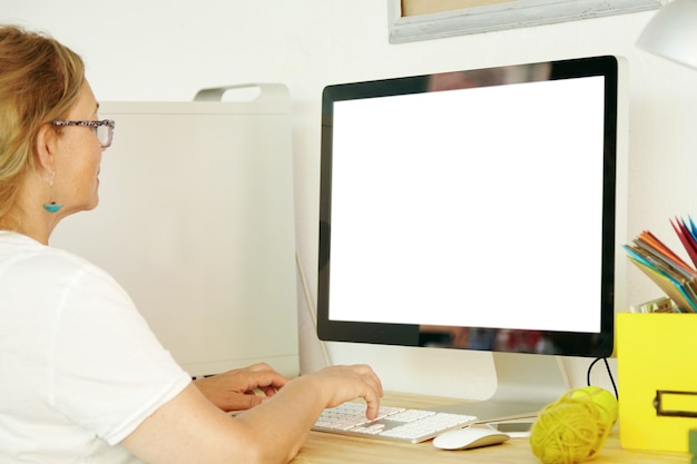 Elderly woman using blank screen computer