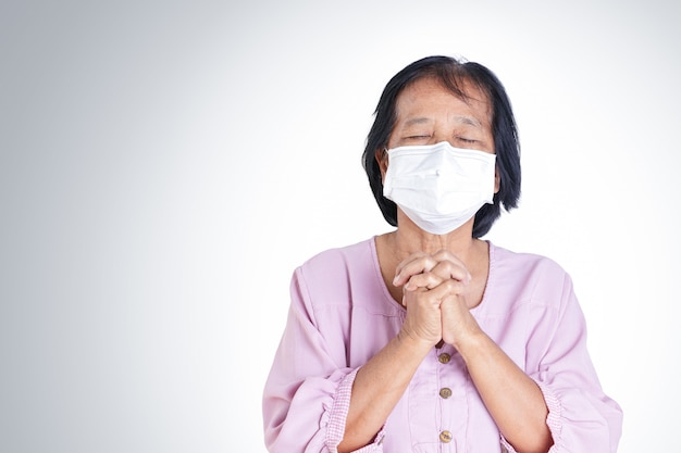 Elderly woman wearing masks, covering their mouths and noses, preventing coronavirus or covid-19