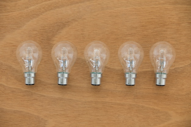 Electric bulbs on wooden plank