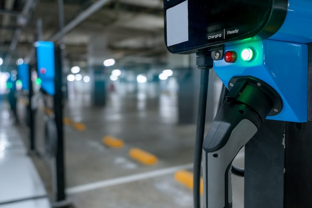 Electric car charging station for charge ev battery. plug for vehicle with electric engine. ev charger.