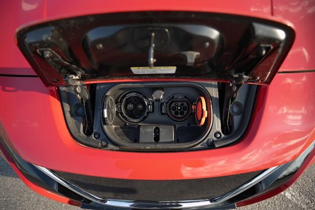 Electric car fuel socket. electric car concept in green environment concept Premium Photo