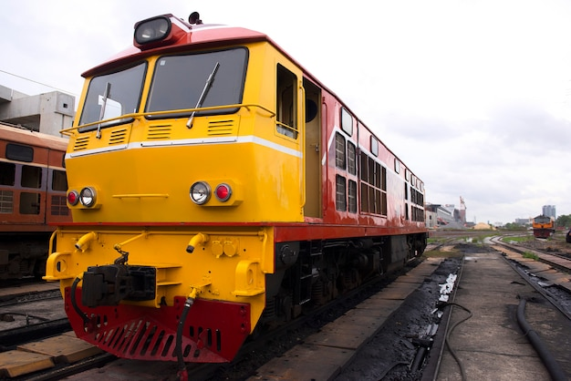 Electric diesel locomotive is waiting for the signal to leave the station