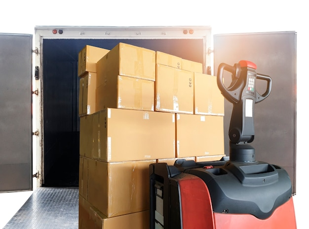 Electric forklift pallet jack loading shipment boxes into cargo continer