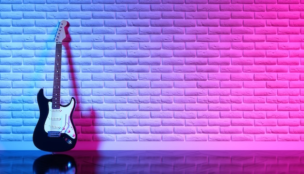 Electric guitar against a brick wall in neon light, 3d illustration