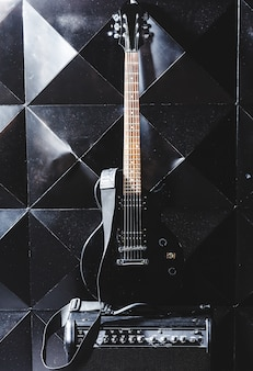 Electric guitar and classic amplifier on a dark background