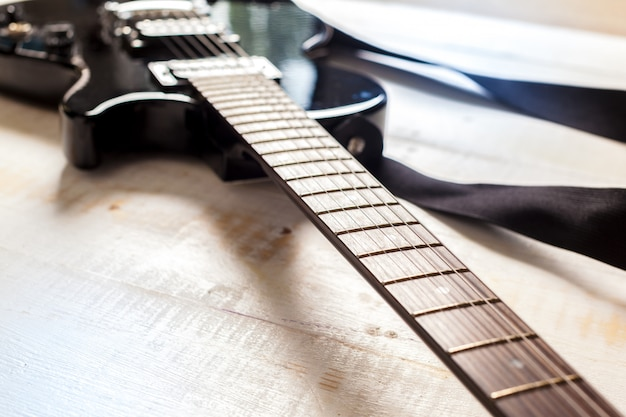 Electric guitar on old wooden surface
