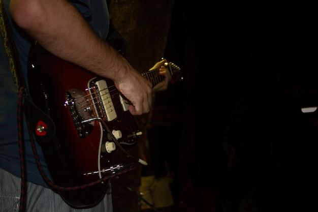 Electric guitar player, closeup photo with soft selective focus