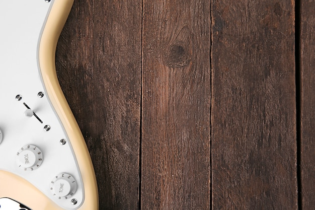 Electric guitar on wooden, close up