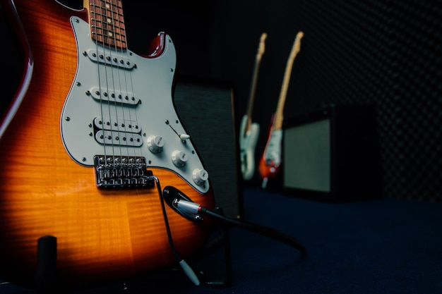 Electric guitars are placed in the rehearsal room.