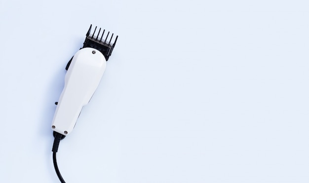 Electric hair clipper on white background.