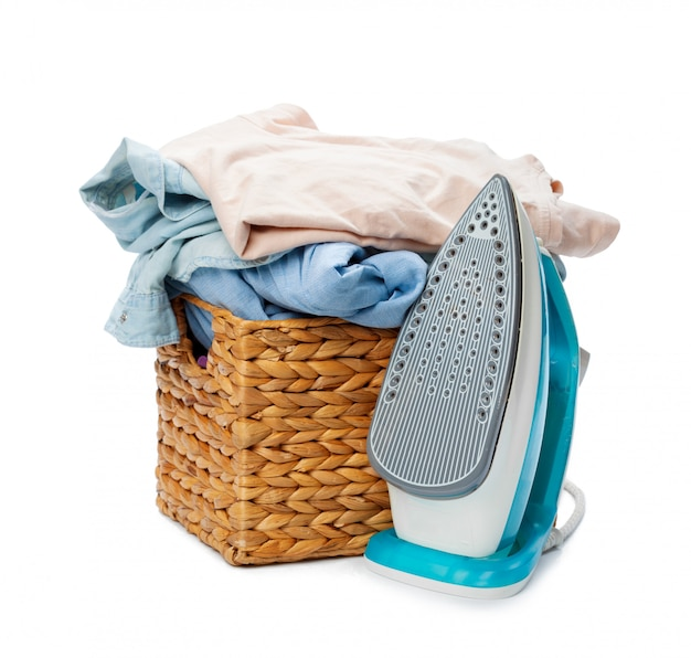 Electric iron and pile of clothes.