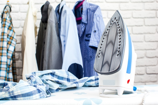 Electric iron and shirt, on cloth