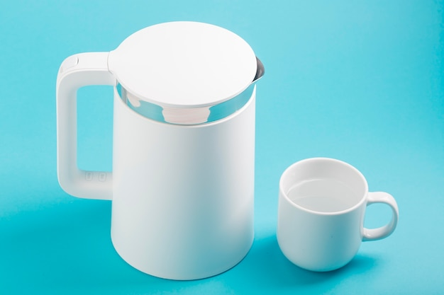 Electric kettle and cup high view