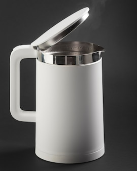 Electric kettle on dark background