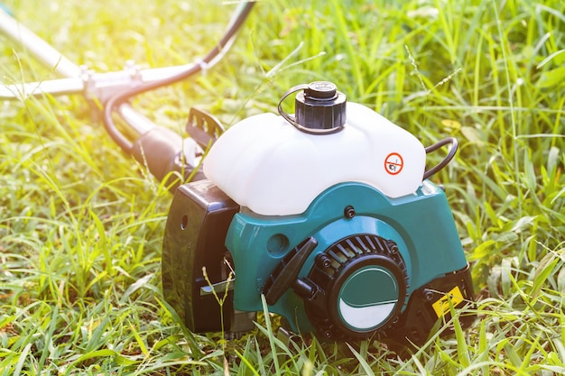 Electric lawn mower on a green grass.selective focus.