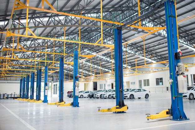 The electric lift for cars in the service put on the epoxy floor in new car factory service