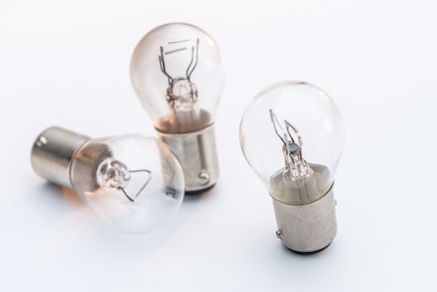 Electric light bulb isolated on color background. eauipment for car headlight, technology