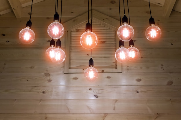 Electric light bulb under the wood ceiling