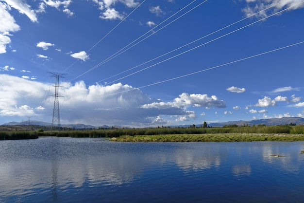 Electric lighting poles crossing a lagoon
