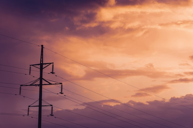 Electric pole on the background of the setting sun.