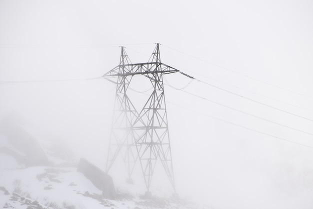 Electric pole on a foggy day