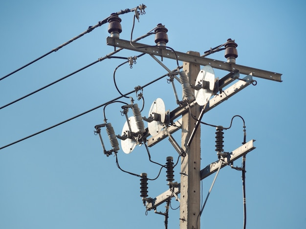 Electric pole with electric transformers and electrical cables