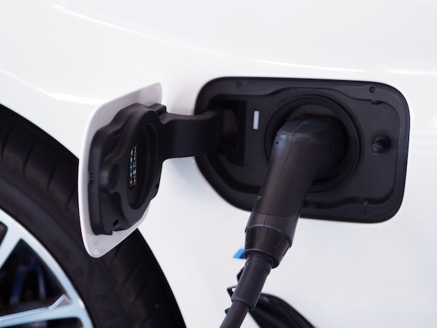 Electric power cars are filling electricity.