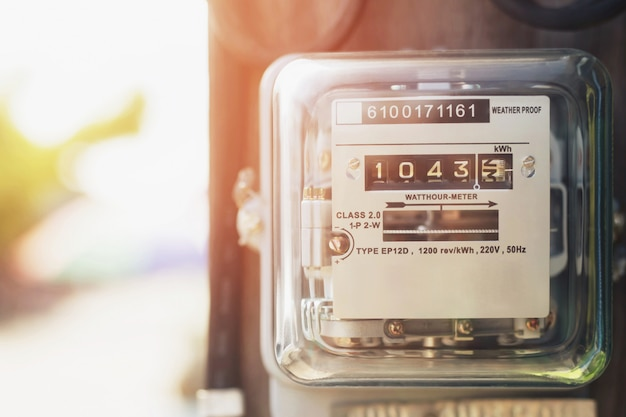 Electric power meter measuring power usage. watt hour electric meter measurement tool at pole