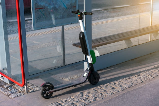 Electric scooters stand along the streets of downtown. public scooter to rent