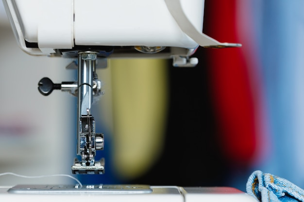Electric sewing machine in a seamstress office
