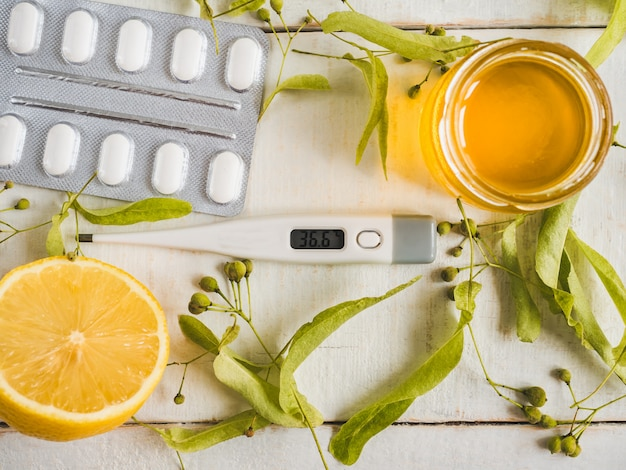 Electric thermometer, pills, lemon. concept of prevention of colds