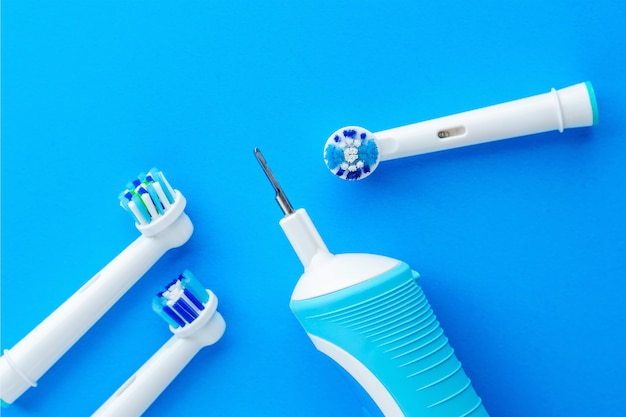 Electric toothbrush on blue background