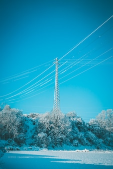 Electric tower in a snowy landscape