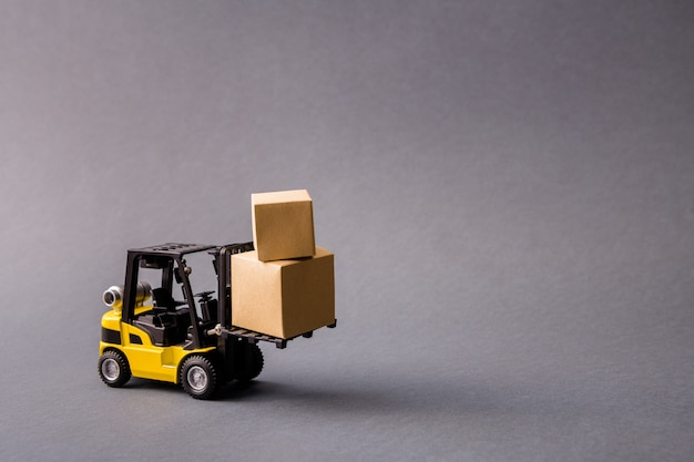 Electric truck carrying bringing delivering stuff in boxes fast shipment