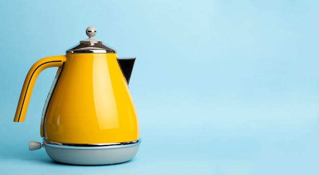 Electric vintage retro kettle on a colored blue background. lifestyle and design concept