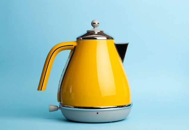 Electric vintage retro kettle on a colored blue. lifestyle and design concept